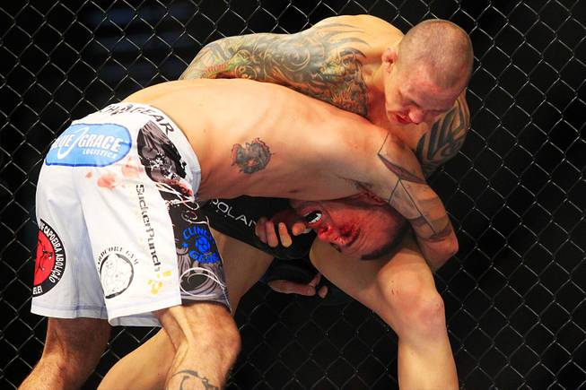 Ross Pearson controls Junior Assuncao during their featherweight bout at UFC 141 Friday, Dec. 30, 2011 at the MGM Grand Garden Arena.