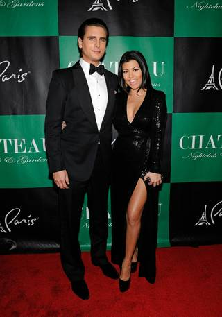 Scott Disick and Kourtney Kardashian arrive to celebrate New Year's Eve at Chateau Nightclub & Gardens at the Paris on Dec. 31, 2011.