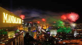 Fireworks light up the sky over the Las Vegas Strip Sunday, Jan. 1, 2012, in this view from the House of Blues Foundation Room at Mandalay Bay.