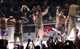 Redfoo, center, of LMFAO at Haze in Aria on Dec. 31, 2011.