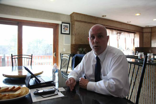 Larry Harrington, chairman of Foxborough's board of selectmen, sits at his kitchen table and explains why he thinks the Kraft-Wynn casino proposal deserves to be heard out by the town residents and why the tax revenue it would bring would be a boost to the town.