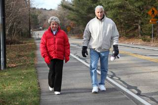 Cecelia and Frank Colella walk along a street in Foxborough. The 50-year residents say introducing a casino will destroy the character of their town.
