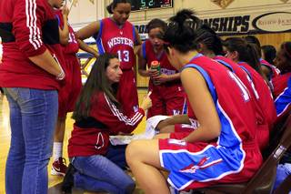 Western coach Annette Megown talks to her team during a time out in their game against Bonanza Tuesday, Jan. 3, 2012 at Bonanza High School.