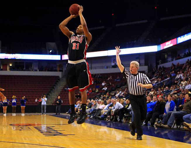 UNLV guard Justin Hawkins takes a three point shot against Cal State-Bakersfield during their game Thursday, Jan. 5, 2012 at Rabobank Arena in Bakersfield. UNLV won their final non-conference game 89-57. Hawkins was 4 for 7 from three point range and finished with 17 points.