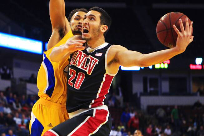 UNLV's Karam Mashour drives past Cal State-Bakersfield forward Adam Young during their game Thursday, Jan. 5, 2012 at Rabobank Arena in Bakersfield. UNLV won their final non-conference game 89-57.