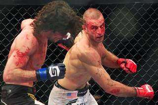 Tarec Saffiedine hits Tyler Stinson during their match at Strikeforce: Rockhold vs. Jardine Saturday, Jan. 7, 2012.  Saffiedine won by split decision.
