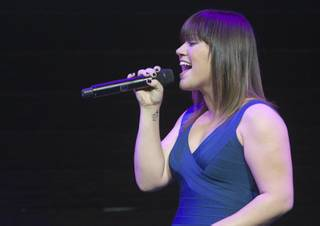 Singer Kelly Clarkson performs during a Sony news conference at the Las Vegas Convention Center on Jan. 9, 2012.