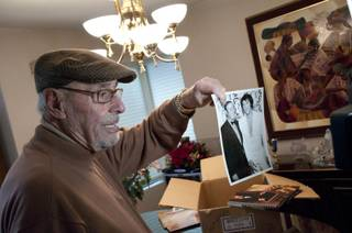 Long-time Las Vegas resident, Emilio Muscelli, shows off a photograph of him posing with Elvis Presley, Monday Jan. 9, 2012. Emilio worked as Vegas' most beloved maitre'd of the Hilton, and the International before that, and befriended many important people in the
