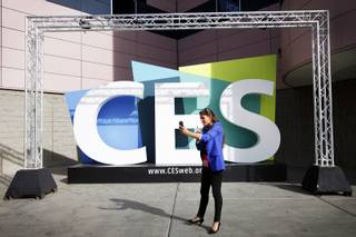 Belgian journalist Tatiana Silva records a stand up with a smart phone during the Consumer Electronics Show outside of the Las Vegas Convention Center on Monday, Jan. 10, 2012.