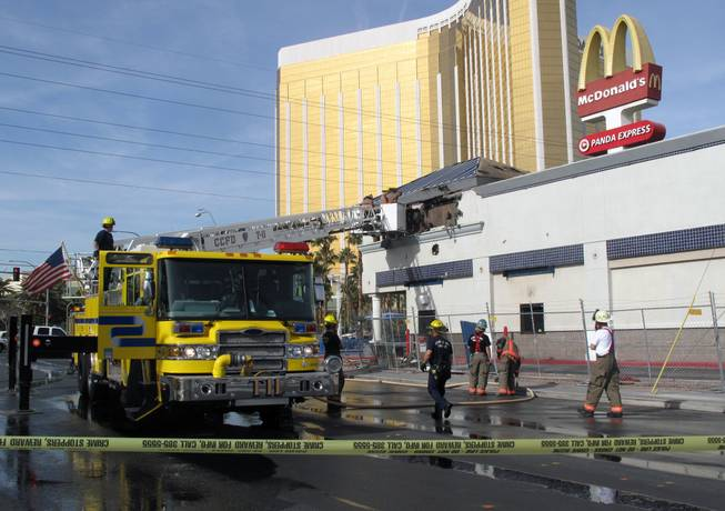 Clark County firefighters responded to a two-alarm fire Monday morning at the McDonald's located across the street from Mandalay Bay. No one was injured.