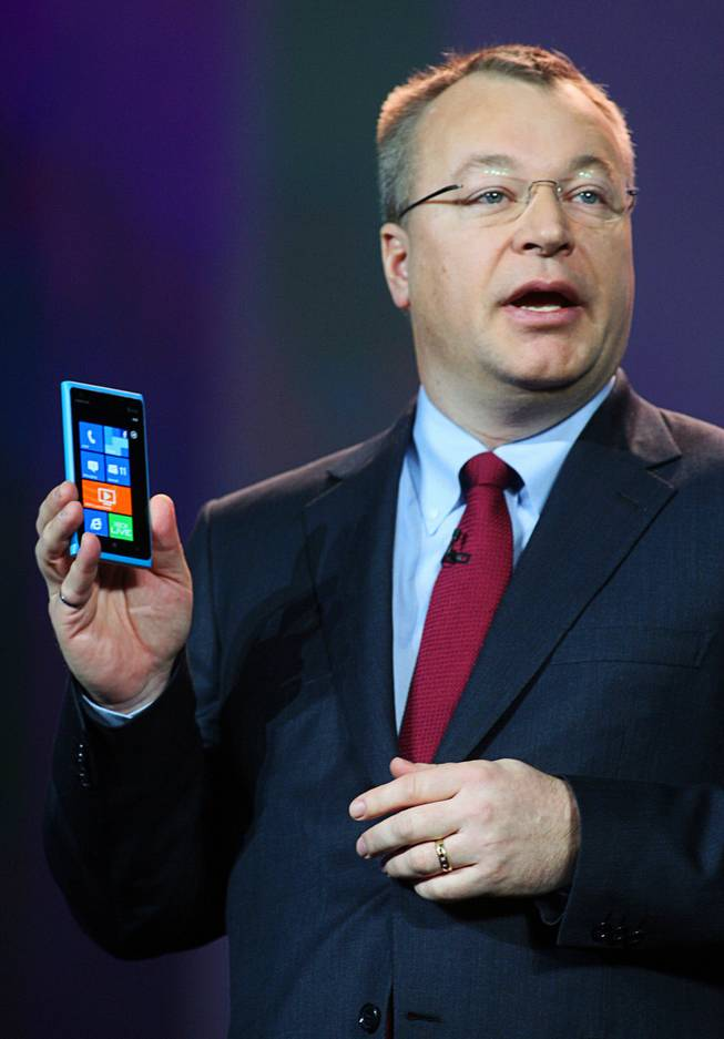 Stephen Elop, CEO of Nokia, holds a Lumina 900 Windows smartphone during a Qualcomm keynote address at the 2012 International Consumer Electronics Show (CES) in Las Vegas, Nevada, January 10, 2012.  The phone uses a Qualcomm Snapdragon processor.