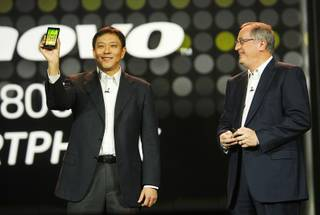 Liu Jun (L), Lenovo senior vice president and president of Mobile Internet and Digital Home, introduces the Lenovo K800 smart phone, based on Intel technology, during a keynote address by Paul Otellini (R), president and CEO of Intel Corporation, at the 2012 International Consumer Electronics Show (CES) in Las Vegas, Nevada, January 10, 2012. The phone will be available in Chine in the second quarter of 2012, he said. CES, the world's largest consumer technology tradeshow, runs through Friday.