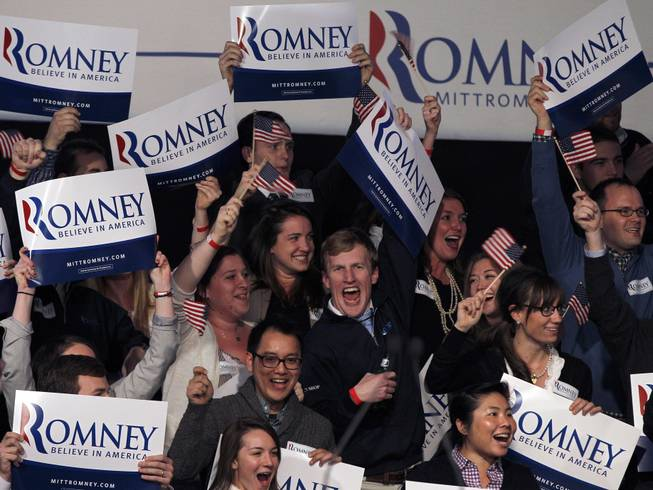 Supporters at the Romney for President primary-night rally at Southern New Hampshire University in Manchester, N.H., Tuesday, Jan. 10, 2012, cheer as it is announced that the election has been called for former Massachusetts Gov. Mitt Romney.