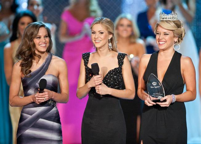 Miss Americas Katie Stam (2009), Kirsten Haglund (2008) and Teresa Scanlan (2011) attend the second-night preliminary competition in the 2012 Miss America Pageant at Planet Hollywood on Jan. 11, 2012.