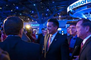 Nevada Governor Brian Sandoval takes a tour of the Consumer Electronics Show, Wed. Jan 11, 2012.