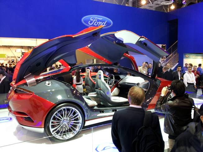 Ford's EVOS concept car sports doors that open up, and a modern, spartan interior.