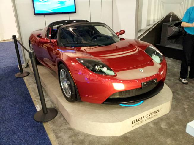 Exhibitors at the 2012 CES often use cars to showcase products.  In some cases, the car is the product.  These cars are scattered across the exhibit floor, but they all have one thing in common, Luxury.