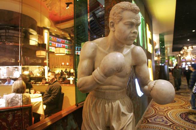 A statue of boxing legend Joe Louis stands outside Caesars Palace's race and sports book.