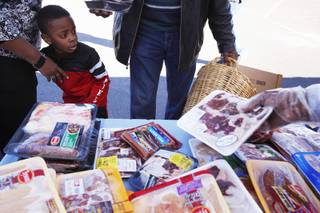 Ezreal Williams, 5, of Las Vegas accompanies his grandparents at a mobile food bank organized by Family Youth Enrichment at Grace Immanuel Baptist Church in Las Vegas on Friday, Jan. 13, 2012.