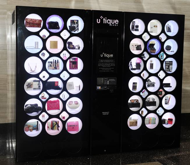 The futuristic machine holds a collection of 56 items, including luxury brands like Lancome, Smashbox, Beats by Dre headphones, The Art of Shaving and Jonathan Adler accessories.