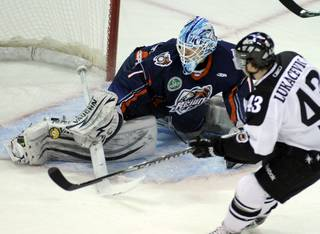 Ontario netminder Chris Carozzi gets a pad on a shot by Ned Lukacevic as the Wranglers hosted the Reign on Friday night at the Orleans Arena.