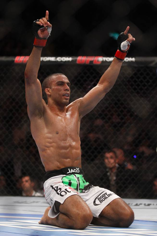 Edson Barboza, from Brazil, celebrates after defeating Terry Etim, from the UK, during their lightweight mixed martial arts bout at UFC 142 in Rio de Janeiro, Brazil, Sunday, Jan. 15, 2012.