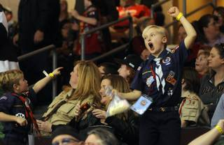 Ken Haley, 8, gives his all while cheering on the Wranglers on Saturday night as Las Vegas hosted the Ontario Reign for a second night at the Orleans Arena. Local Boy Scouts were recognized on the ice Saturday night for their popcorn sales throughout the past year; hundreds of scouts were in attendance.