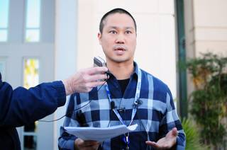 Zappos CEO Tony Hsieh responds to questions from the media on Monday, January 16, 2012, one day after the online retailer's website was hacked. The cyber-attack did not compromise Zappo's credit card database, but the hacker may have accessed users' personal data such as name, address, billing and shipping addresses, phone numbers, the last four digits of their credit card numbers and online passwords.