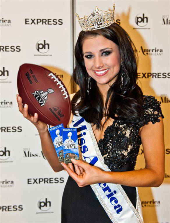 2012 Miss America Laura Kaeppeler with an official Super Bowl XLVI football and tickets.
