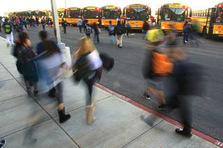 Students make their way to buses after classes at Del Webb Middle School Tuesday, Jan. 17, 2012.