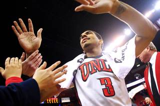 UNLV guard Anthony Marshall greets fans after the Rebels dispatched TCU 101-78 during their Mountain West Conference game Wednesday, Jan. 18, 2012 at the Thomas & Mack Center.