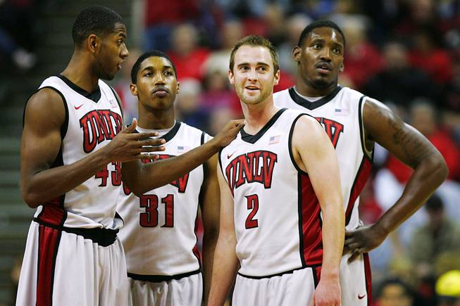UNLV players, from left, Mike Moser, Justin Hawkins, Kendall Wallace and Quintrell Thomas wait for Anthony Marshall to shoot free throws after a flagrant foul by TCU during their Mountain West Conference game Wednesday, Jan. 18, 2012 at the Thomas & Mack Center. UNLV won the game 101-78.