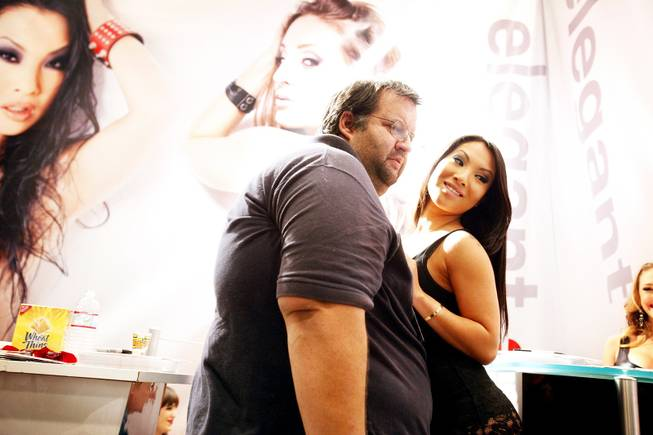 Asa Akira of Elegant Angels poses for a photo with Ed Aristeguieta of Las Vegas at the AVN Adult Entertainment Expo 2012 inside the Hard Rock Hotel on Thursday, Jan. 19, 2012.