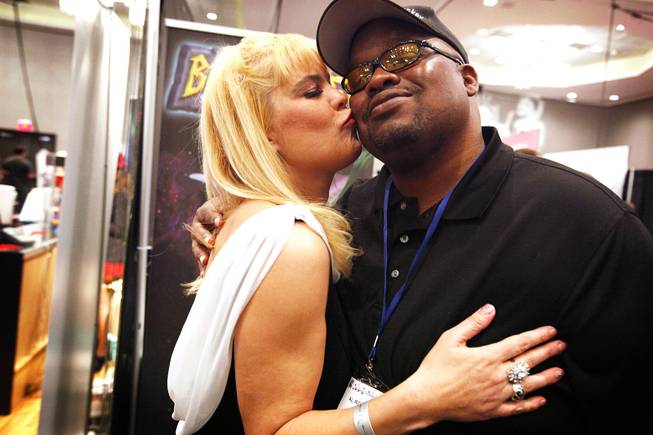Adult star Sunset Thomas greets her friend Al Roker Jr. at the AVN Adult Entertainment Expo 2012 inside the Hard Rock Hotel on Thursday, Jan. 19, 2012.