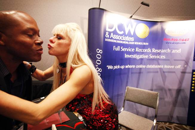 Andre Haynes of Las Vegas receives a kiss from Tarryn Wylde of DCW ...