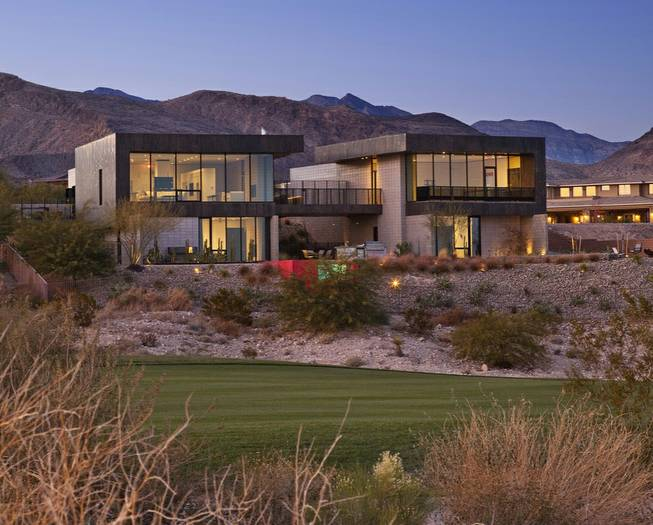 Architect Eric Strain designed this award-winning house on a hillside in Summerlin to be adaptable to the desert. There are no windows at the rear because they would face west -- and the punishing afternoon heat. Instead, the back of the home is garage, which acts a buffer between the living space and the sun.