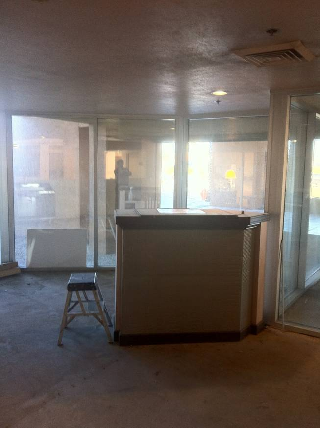 The check-in counter at the old Atrium Suites, still on property, its future unclear.