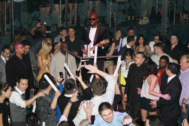 Wyclef Jean performs at the Bank in the Bellagio on ...