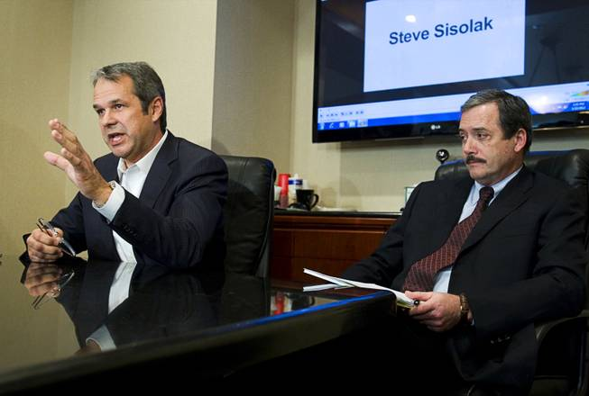 Mark Fierro, left, a public relations expert, and Robert Martin, attorney for former Henderson City Councilwoman Kathleen Vermillion, respond to questions during a news conference at the Martin & Allison law offices Monday, Jan. 23, 2012. The pair disputed allegations by Clark County Commissioner Steve Sisolak that Vermillion, Sisolak's former girlfriend, Fierro and Martin were involved in an an extortion attempt.