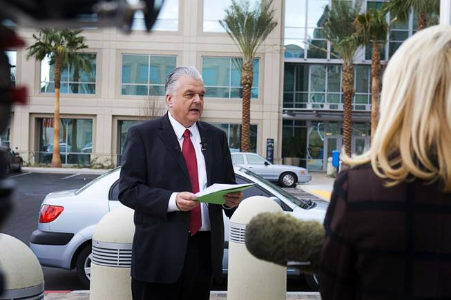 Clark County Commissioner Steve Sisolak speaks at a news conference outside Metro Police Headquarters Monday, Jan. 23, 2012. Sisolak said he has filed a criminal complaint against his former girlfriend and former Henderson Councilwoman Kathleen Vermillion alleging that she tried to extort  $3.9 million from him.