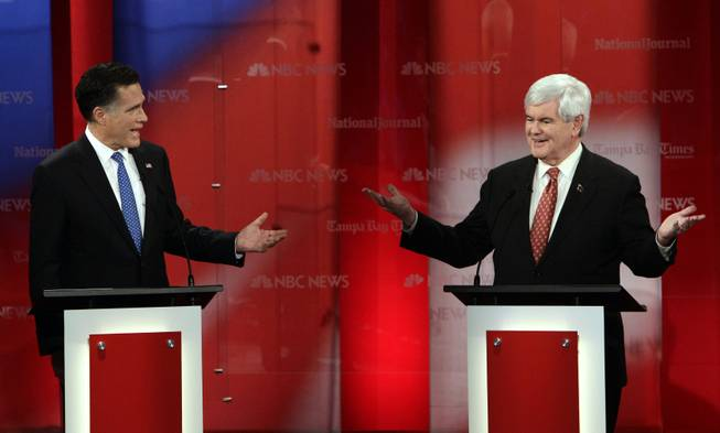 Republican presidential candidates Mitt Romney, left, and Newt Gingrich gesture during a Republican presidential debate Jan. 23, 2012, at the University of South Florida in Tampa, Fla.