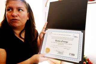 Belem Ortega holds up a certificate she got from CCSD inside her Las Vegas home on Jan. 24, 2012.