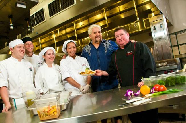 "Food Network Chef Guy Fieri pays a visit to UNLV's culinary department while shooting for his show ""Diners, Drive-ins and Dives"" on Thursday, Jan. 26, 2012. Fieri, a UNLV alumnus, caught up with instructor Vincent Eade, who was Fieri's faculty adviser, and taught students some tricks of the trade."