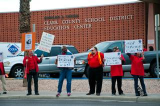 Teachers gather in front of the Clark County School District Education Center on East Flamingo Road on Thursday, Jan. 26, 2012, to speak out against the School Board, which was holding a meeting inside.