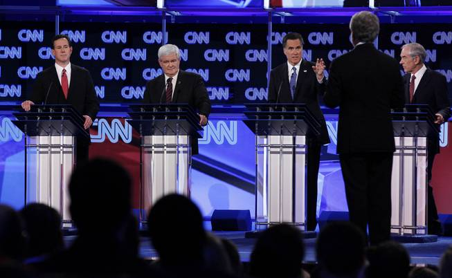 Republican presidential candidates, from left, Rick Santorum, Newt Gingrich, Mitt Romney and Ron Paul look toward moderator Wolf Blitzer of CNN as they participate in the Republican presidential candidate debate in Jacksonville, Fla., on Jan. 26, 2012.