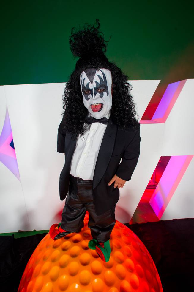 "KISS By Monster Mini Golf Spokesman Brian ""Lowercase g"" Thomas, standing atop a very large golf ball."