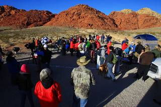 Some of an estimated 150 volunteers assemble in Calico Basin to search for missing outdoorsman and athlete Ron Kirk Saturday, Jan. 28, 2012.