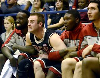 UNLV players react from the bench during overtime of the Rebels' 65-63 win Saturday, Jan. 28, 2012, at Air Force.