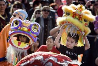 Caitlin Lamug, left, 7, and Antonio Aja, 5, perform a lion dance during the 18th Chinese New Year Celebration & Festival at the Chinatown Mall Sunday, Jan. 29, 2012. The festival was organized by the Chinese Chamber of Commerce and the Chinatown Mall.