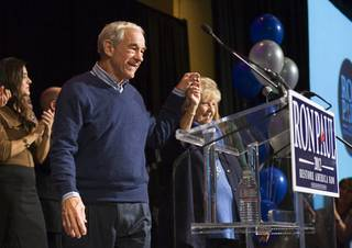 Republican presidential candidate Rep. Ron Paul, R-Texas, and his wife, Carolyn, arrive for a rally at the Green Valley Ranch Resort in Henderson on Tuesday, Jan. 31, 2012.